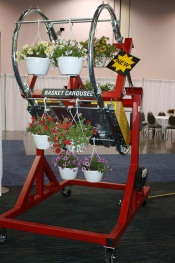 Mechanized Basket Elevator Makes Loading Conveyors Easier