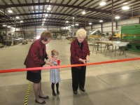 Three generations of Nexus Corporation family members cut the ribbon to the new facility.