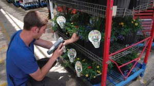 At Metrolina Greenhouses, a handheld scanner reads the bar code on each cart, along with the UPC for each unique item on each cart shelf. Once the items are scanned, a label is printed with a barcoded list of the items and quantities on the cart. Photo by Amanda Tomaini, Practical Software Solutions