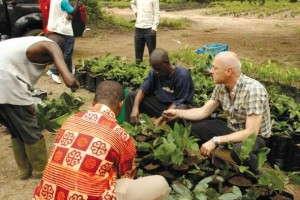 Garry Grueber (far right) planted breadfruit plants in Ghana.