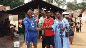 Josh Schneider (second from left) delivered the first breadfruit plants to Liberia earlier this year.