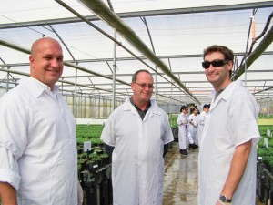 Mitch McDonald (middle) and son Aaron (right) tour Oro Farms in Guatemala.