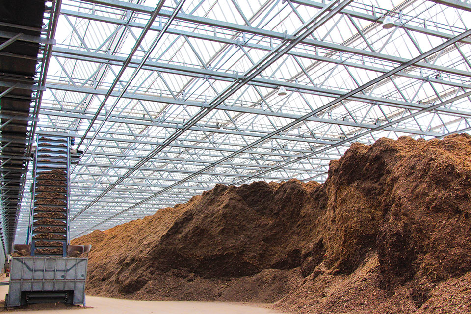 Metrolina Greenhouses keeps a 4-acre barn filled with wood chips, sourced locally from forestry waste and old pallets. The barn can hold a three- to four-week supply of wood chips