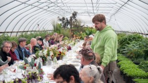 Dean Englemann talks to his guests at a Tangletown farm dinner FEATURE
