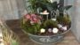 Grapevine Balls, Glass House, and Galvanized Dish Gardens (Flori-Design, Inc.)