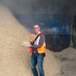 Brian Jackson in wood fiber production bin