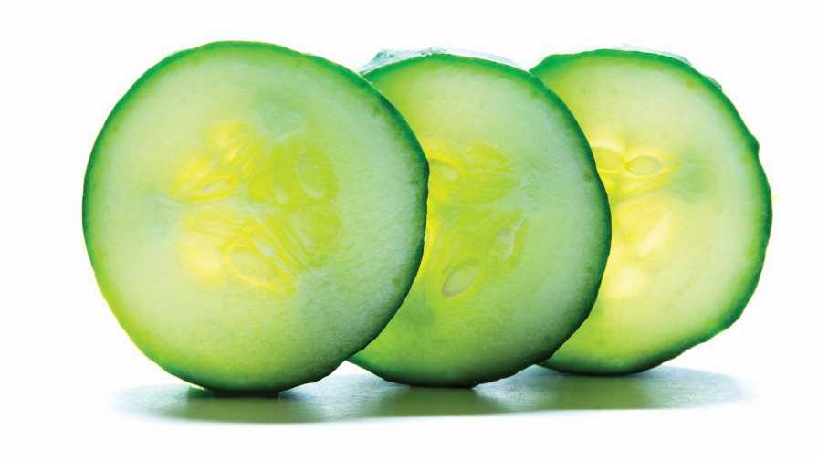 Row of sliced cucumbers